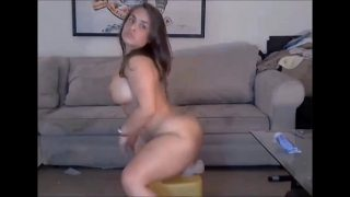 Big ass brunette rides thick dildo on webcam